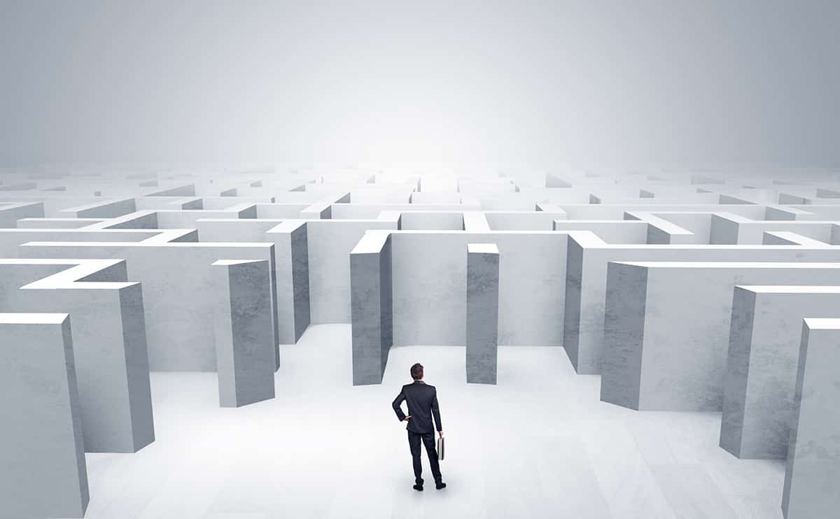 Businessman can not decide which entrance he chose outside of the maze